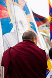 Tibetan monk holding a flag. Demonstration for a free Tibet. Protest against Chinese occupation. Paris, March 10th 2012 Stock Image