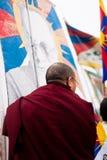 Tibetan monk holding a flag Stock Image