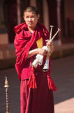 Tibetan Monk with prayer instrument Royalty Free Stock Images