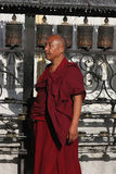 Tibetan Monk and Prayer Wheels Stock Photography