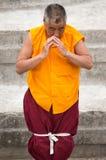 Tibetan monk praying at the Boudhanath Stupa Royalty Free Stock Image