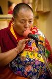 Tibetan monk sings , Dalai Lama temple, McLeod Ganj, India Stock Photography