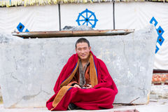 Tibetan monk sitting Royalty Free Stock Photos