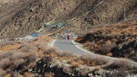 Tibetan monk. Walks around Holy Mountain in Tibet Royalty Free Stock Images