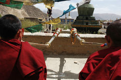 Tibetan monks blowing bugles. Two Tibetan monks(lamas) playing trumpet on the roof of a lamasery in Tibet,used for news and articles about the religion and Stock Photography