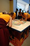 Tibetan Monks and Mandala at Hammer Royalty Free Stock Image