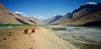 Tibetan monks resting by the Spiti Valley Royalty Free Stock Photo
