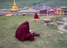 Tibetan monks sitting on the hill stock photo