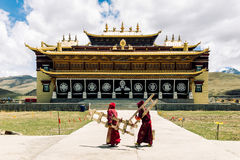 Tibetan monks by tradtitional tibetan monastery by Tagong grassland in China Royalty Free Stock Photos