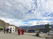 Tibetan monks walk in Leh, India Stock Photography