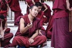 Tibetan monks were debating. In the courtyard at Sera monastery Royalty Free Stock Image