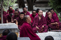 Tibetan monks were debating. In the courtyard at Sera monastery Stock Image