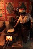 Tibetan woman cooking  Royalty Free Stock Images