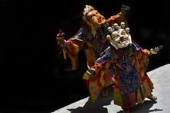 Tibetan mystical Dance of Masks, dance of lamas high tantric satellites in masks. Spirits of the terrain. Tibetan mystical Dance of Masks, dance of lamas of Stock Photography