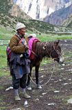Tibetan nomad. SHEY, NEPAL - SEPTEMBER 04: Tibetan herdsman with horse from the village of Tibatan refugees on September 04, 2011 in Shey Gompa, Dolpo district Stock Photo