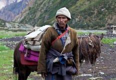 Tibetan nomad. TSAKANG, NEPAL - SEPTEMBER 04: Tibetan nomad with horse from the village of Tibatan refugees on September 04, 2011 in Tsakang, Dolpo district Royalty Free Stock Photos