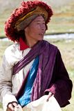Tibetan nomad. DHO TARAP, NEPAL - SEPTEMBER 11: An unidentified smiling Rnying-ma-pa Tibetan monk posing for the photo during the local Dho Tarap Full Moon Royalty Free Stock Photo