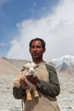 Tibetan nomad with goatling, India. LADAKH, INDIA - JUNE 15: Portrait of Tibetan nomad with goatling poses for a photo on June 15, 2012 in Ladakh, Jammu and royalty free stock photos