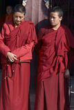 Tibetan Nuns. Two Tibetan Buddhist Nuns at Boudhanath Stupa, Kathmandu, Nepal Royalty Free Stock Photo