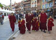 Tibetan Nuns Walking Around Boudhanath Stupa Stock Photos