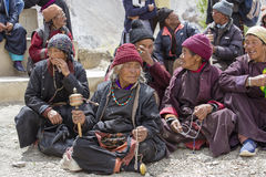 Tibetan old people during mystical mask dancing Tsam mystery dance in time of Yuru Kabgyat Buddhist festival at Lamayuru Gompa, La Stock Photos
