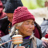 Tibetan old people during mystical mask dancing Tsam mystery dance in time of Yuru Kabgyat Buddhist festival at Lamayuru Gompa, La Stock Photography