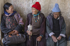 Tibetan old women during mystical mask dancing Tsam mystery dance in time of Yuru Kabgyat Buddhist festival at Lamayuru Gompa, Lad Royalty Free Stock Photography