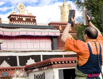 Tibetan outside a temple praying. A tibetan monk praying outside a temple in Tibet of China.Time:Aug.26/2010 Royalty Free Stock Image