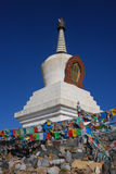 Tibetan pagodas. A  white pagoda  with  wind-horse flags   in Tibet Stock Images