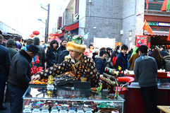 Tibetan  peddler. A Tibetan  peddler is selling goods at culture  street Tianjin China Royalty Free Stock Photo