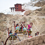 Tibetan people at fairground enjoying ferris wheel Royalty Free Stock Photos