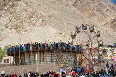 Tibetan people at fairground enjoying ferris wheel Royalty Free Stock Photography