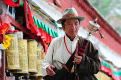 Tibetan pilgrim circles the Potala palace Stock Images