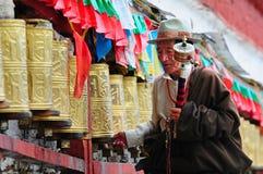 Tibetan pilgrim circles the Potala palace Stock Photos