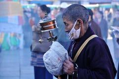 Tibetan pilgrim. The Tibetan pilgrim praying at the Jokhang Monastery, Lahsa Royalty Free Stock Photography