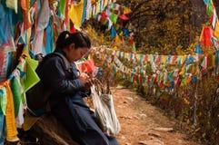 A Tibetan Pilgrim Praying in Yubeng Royalty Free Stock Photos