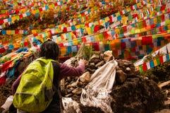 A Tibetan Pilgrim Praying in Yubeng Stock Photography