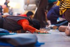 Tibetan Pilgrim Prostrating Flat Ground Jokhang Royalty Free Stock Photography