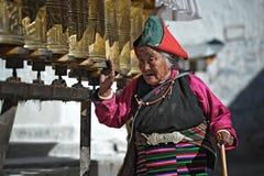 Tibetan pilgrims circle the holy Pelkor Chode monastery royalty free stock image