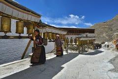Tibetan pilgrims circle the holy Pelkor Chode monastery Stock Photo
