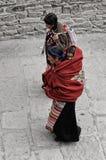 Tibetan pilgrims circle the holy Pelkor Chode monastery Royalty Free Stock Photography