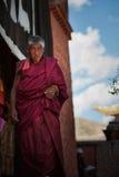 Tibetan pilgrims. Elderly Tibetan pilgrims in China Stock Photos