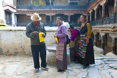 Tibetan pilgrims make offerings Royalty Free Stock Images