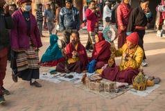 Tibetan pilgrims sing traditional Buddhist songs. Royalty Free Stock Photography