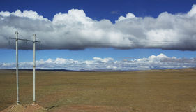 Tibetan Plateau. Clouds dominate the landscape over the Tibetan Plateau royalty free stock photography