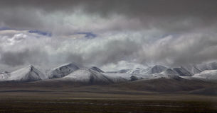 Tibetan Plateau. Clould cover snow-capped mountains in Tibet Stock Images
