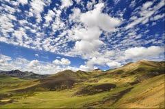 Tibetan Plateau. Mountains and blue sky on tibetan plateau stock photography