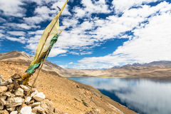 Tibetan prayer flag overlooking Tso Moriri (lake Moriri) in Lada Stock Image