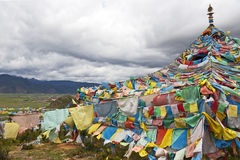 Tibetan Prayer Flags. Thickly amassed into a tent shape atop a small hill in northern Yunnan province, China Stock Photo