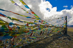 Tibetan prayer flags. A background of Tibetan prayer flags flying against the blue sky Stock Photo